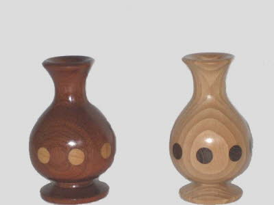 A pair of inlaid vases by George Hill